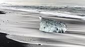 Icebergs on black volcanic beach. Beach of the north atlantic near the glacial lagoon Joekulsarlon and glacier Breithamerkurjoekull in the Vatnajoekull NP. europe, northern europe, iceland, February.