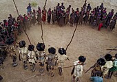 Aerial view of dimi ceremony in the Dassanech tribe to celebrate circumcision of teenagers, Omo Valley, Omorate, Ethiopia.