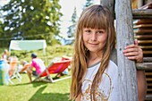 Portrait of playful young female child during family meetup in rural scene in Bavaria, Germany