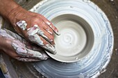 Passionate hands creating pottery with natural clay