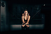 Portrait of confident woman exercising at gym