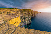 Cliffs of Moher Aillte an Mhothair , Doolin, County Clare, Munster province, Ireland, Europe, Sunset over the cliffs