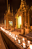 Yangon, Myanmar Burma , Rows of candles in the Shwedagon pagoda at night