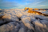 Aerial shot from Seceda of Odle surrounded by clouds at sunset, Dolomites Val Funes Trentino Alto Adige South Tyrol Italy Europe