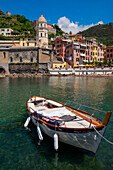 Vernazza, Liguria, Italy The church of Vernazza recovery from the small port of the country, In the foreground you see a boat moored