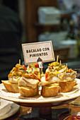 Bacalao con pimientos (codfish with peppers). Typical Pintxos, also called tapas at popular San Sebastian bar, Basque Country, Spain.