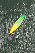 Directly above shot of man with upside down kayak in water