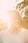 Close-up portrait of confident young woman on sunny day