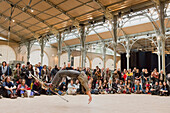 Europe, France, Paris (75), 3rd arrondissement, Le Marais, the 'Carreau du Temple'. April 25th, 2014. Opening day. Funny Acrobatic show by the Kadavresky corporation. It is a former clothes market that was redeployed in a cultural and sport center in 2014
