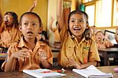 Indonesia, Bali, Bedulu. pupils girls and boys in uniform in a primary school.