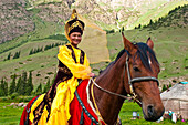 Kyrgyzstan, Issyk Kul Province (Ysyk-Kol), Juuku valley, Goulzana Talantbekoze wears the traditionel Kiz Kumai clothes, a horse game where the man tries to catch a girl on horseback and kiss her