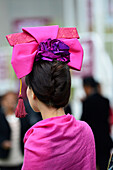 France, Paris 16th district, Longchamp Racecourse, Qatar Prix de l'Arc de Triomphe on October 4th and 5th 2014, closeup of an elegant and fashionable young lady seen from behind, wearing a hat