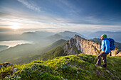 Hiker at Mount Schafberg, view to Lake Attersee, St. Wolfgang, Upper Austria, Austria, Europe