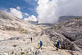 Hikers in karst landscape, Totes Gebirge, Bad Aussee, Styria, Austria, Europe