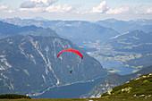 Paraglider above Lake Hallstaettersee, seen from Mount Krippenstein, Upper Austria, Austria, Europe