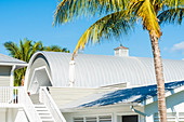 The boat house of a noble villa framed by palm trees, Boca Grande, Florida, USA