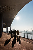 Morning atmosphere at the plaza Elbphilharmonie with view at the docks, Hamburg, Germany