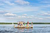 Kids swimming, beach, playing in the water, near campsite Havelberge, lake Woblitzsee, holiday, summer, swimming, sport, Mecklenburg lakes, Mecklenburg lake district, Granzow, Mecklenburg-West Pomerania, Germany, Europe