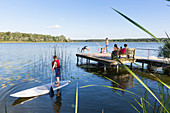 Swimming, diving into water, family, stand up paddling, SUP, playing in the water, holiday, summer, swimming, sport, lake Neuklostersee, Mecklenburg lakes, Mecklenburg lake district, Neukloster, Mecklenburg-West Pomerania, Germany, Europe
