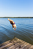 Man diving into water, plunge, swimming, diving into water, family, playing in the water, holiday, summer, swimming, sport, lake Neuklostersee, Mecklenburg lakes, Mecklenburg lake district, MR, Neukloster, Mecklenburg-West Pomerania, Germany, Europe
