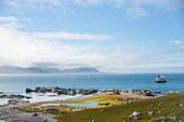 Tourists and expedition ship Sea Spirit (Poseidon Expeditions) on island of Gnalodden, Spitzbergen, Svalbard