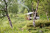 The saunahut of the hut Teusajaurestugorna, trekking on Kungsleden. Lapland, Sweden.