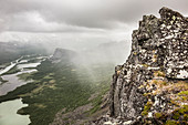 Rain and clouds over Sarek national park. View from Skierffe mountain on to Rapadalen/Laidaure Delta, Sarek national park, Laponia, Lappland, Sweden. Trekking on Kungsleden