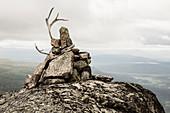 Reindeer antler on cairn. View from Skierffe mountain on to Rapadalen/Laidaure Delta, Sarek national park, Laponia, Lappland, Sweden. Trekking on Kungsleden