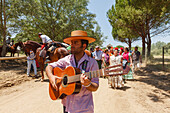 pilgrim with guitar, El Rocio, pilgrimage, Pentecost festivity, Huelva province, Sevilla province, Andalucia, Spain, Europe