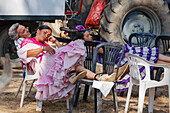 Siesta next to the tractor, El Rocio pilgrimage, Pentecost festivity, Huelva province, Sevilla province, Andalucia, Spain, Europe
