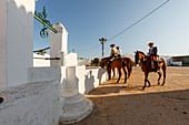 Horse riders at a water trough, El Rocio pilgrimage, Pentecost festivity, Huelva province, Sevilla province, Andalucia, Spain, Europe
