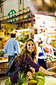 Smiling Woman Shopping In The Market During Vacation In Puerto Rico