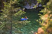 Evan Howard, an avid Explorer and adventurer packrafts the Chehalis River, British Columbia, Canada.