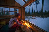 Girl Lightning The Candles To Eliminate The Darkness Inside The Wooden House