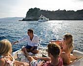 Teenagers enjoy boat ride on Mediterranean Sea