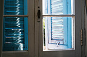 Old Shabby Chic Window with  Blue Shutters from inside, Liguria, Italy, Europe