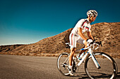 Endurance athlete Neil Sanchez trains with his road bike near Agua Dulce in the Antelope Valley.