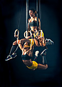 Multiple Exposure Of Crossfit Athlete Doing Muscle-up