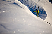 Man With Skiboard Hiking In Snowy Region Of Lake Tahoe, California, Use