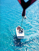 PROVIDENCIALES,TURKS AND CAICOS : First person view as a parasailer leaves a boat. Off of Grace Bay Beach, Providenciales, Turks and Caicos, British West Indies.