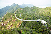 Langkawi cable car is the steepest cable car ride on earth and takes visitors up 708m above sea level to the curved pedestrian sky bridge is built atop Langkawi's second highest peak of Mt. Machinchang.  Langkawi, officially known as Langkawi the Jewel of