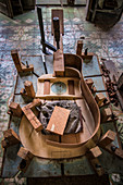 'A Cuban guitar, or tres'' is being clamped together on an intricate clamping jig in a hand-made guitar workshop in Havana, La Habana, Cuba. This exploded view gives you a good idea of the painstaking process. '''