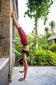 Athlete Woman Doing Handstand In Park