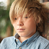 Portrait of tween boy with messy hair