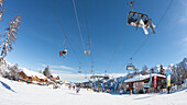 a fisheyed view of the Folgarida ski resort with a lot of tourists on the slopes, Trento province, Trentino Alto Adige, Italy, Europe