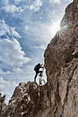 Europe, Italy, Veneto, Belluno, Sexten Dolomites,  a hiker along the via ferrata of the forks in the Paterno , Paternkofel  mount