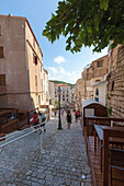 Tourists in the medieval alleys of the old town Bonifacio Corsica France Europe