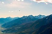 hot air balloon flies over Aosta city, Valle d'Aosta, Italy, Europe