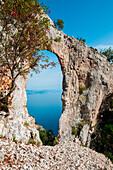 Natural arch, cala mariolu, baunei, ogliastra province, sardinia, italy