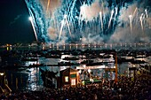 People admire the fireworks and gondolas on the lagoon during the Festa del Redentore in Venice Veneto Italy europe